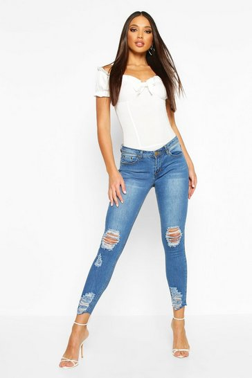 Mid blue blue Mid Rise Distressed Knee And Ankle Skinny Jeans