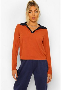 Geripptes Poloshirt im Colorblock-Design, Terrakotta orange