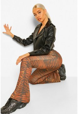 Rust orange Tonal Tiger Printed Jersey Flared Trousers
