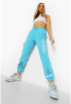 Light blue blå Worldwide Joggers med graffititryck