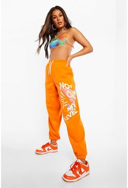 Orange Slogan And Butterfly Print Oversized Jogger