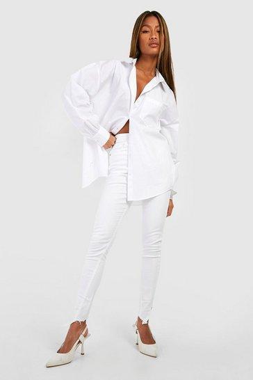 White Distressed Asymmetric Hem Skinny Jeans