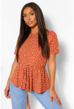 Rust orange Polka Dot Ribbed Peplum Tie Waist Top
