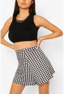 Gonna-pantaloncino flippy in jersey con stampa a quadretti gingham, Nero