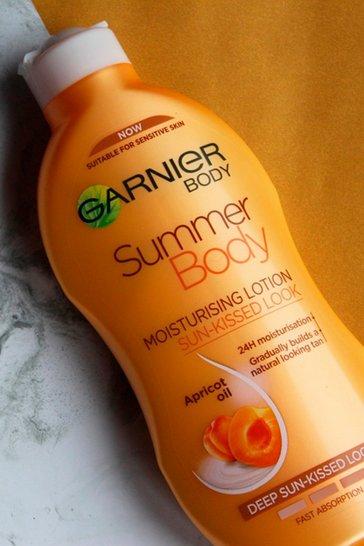 Tan brown Garnier Summer Body Dark Gradual Moisturiser 400ml