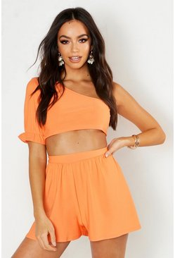 Orange Crop top i one shoulder-modell med volymärm och vida shorts