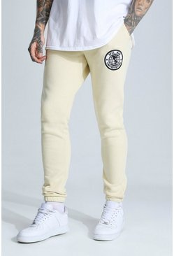 Sand beige Man Embroidered Badge Skinny Joggers