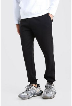 Joggings skinny brodé trait MAN, Noir