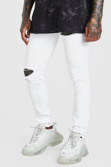 White Skinny Jeans With Multi Rips