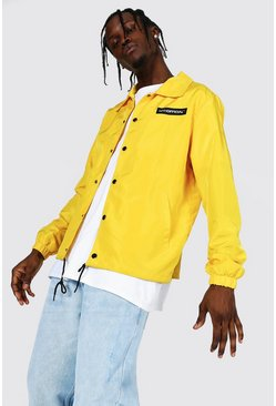 Mustard yellow MAN Official Nylon Coach Jacket
