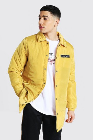 Mustard yellow MAN Official Nylon Longline Coach Jacket