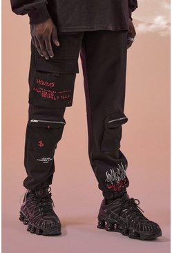 Pantaloni cargo con stampa in stile graffiti MAN Official, Nero