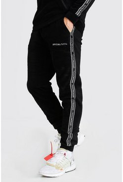 Black MAN Official Slim Fit Polar Fleece Tape Jogger