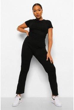 Black svart Plus - Ribbad jumpsuit med slitsar