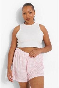 Light pink rosa Plus - Rutiga shorts med vida ben