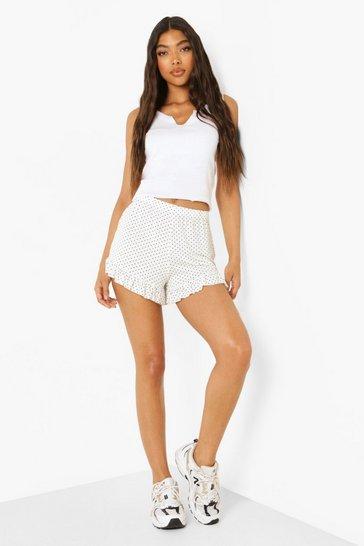 White Tall Polka Dot Ruffle Hem Flippy Shorts